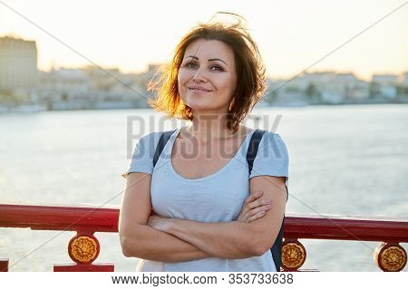 Outdoor Portrait Of Positive Smiling Middle-aged Woman, Happy Successful Confident Female With Folde