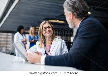 Doctor Talking To A Pharmaceutical Sales Representative.