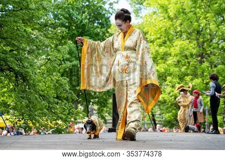 Russia, St. Petersburg, May 25, 2019: Event With Dogs And Their Owners Called Dachshund Parade. Cost