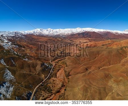 Aerial panorama landscape with road in Atlas Mountains in Morocco.
