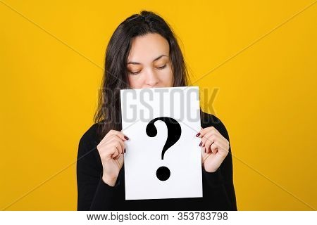 Question Mark, Symbol. Cute Girl Holding A Question Mark Over Yellow Background. Card With Question