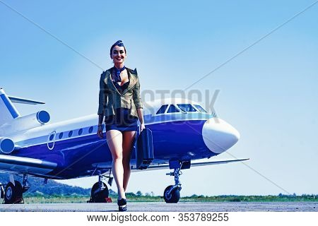 Full Length Of Airhostess On Private Jet Airplane On Airport. Airline. Airplane And Woman. Charming