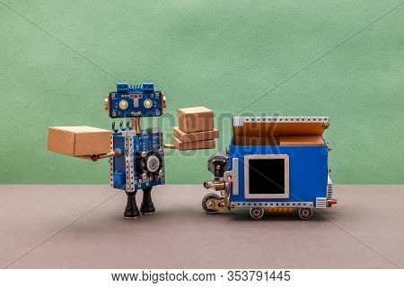 Yellow Eyed Robotics Character Received Parcel Boxes. Autonomous Delivery Truck Vehicle With Black M