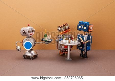 A Four-wheeled Robot Waiter Carries A Tray With Glasses And A Bottle Of Champagne For Two Guests Of