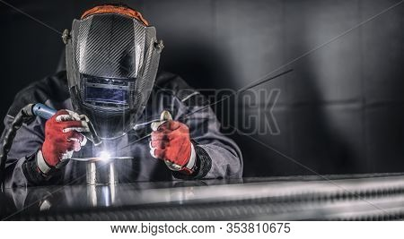 Welder Industrial Worker Welding With Argon Machine.