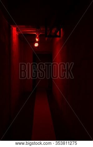 Dark Empty Corridor With Red Light. Concept Of Fear And Mistery