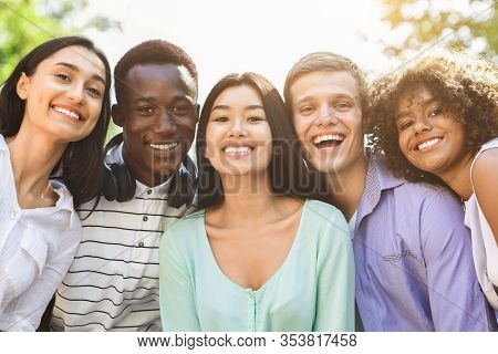 Portrait Of Cheerful Interracial Teen Friends Posing At Camera Outdoors, Smiling And Laughing, Enjoy