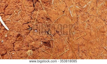 Background Of Natural Brown Adobe Clay Plaster Texture With Straw