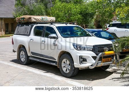 Okaukuejo, Namibia - February 6, 2020: White Pickup Based Campervan Toyota Hilux In The Campsite.