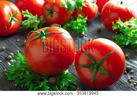 Fresh Tomatoes, Lettuce And Spices On Wooden Table.