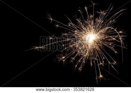 Small New Year Sparkler On Black Background.