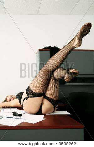 Sensual Woman Laying On Table