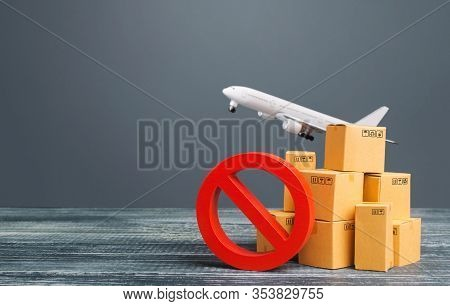 Cardboard Boxes Near A Prohibition Symbol No And Freight Plane. Restrictions Ban On Import Goods. Sa