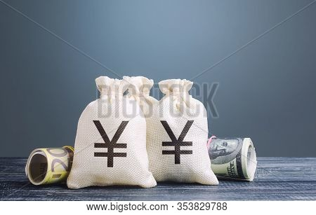 Yen Yuan Money Bags. Capital Investment, Savings. Economics, Lending Business. Profit Income, Divide