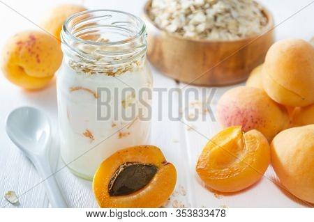 Oatmeal Milkshake, Smoothie Or Yogurt With Fresh Apricot On A White Wooden Table.