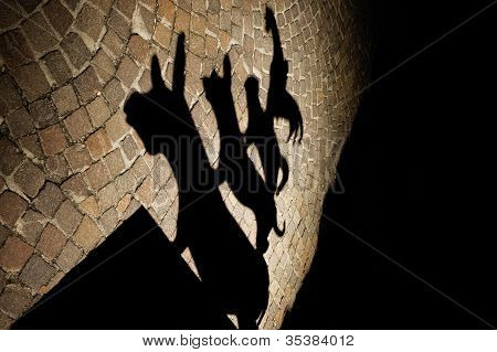 The shadow of the statue of the Bremen Town Musicians poster