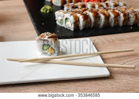 Sushi Unagi Eel Roll On A Plate And Philadelphia Roll On A Background In A Restaurant