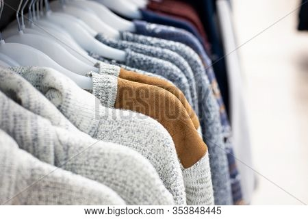 Clothes On Trempel In The Boutique. Sale Of Clothing In The Store. Classic Clothing In A Boutique, A