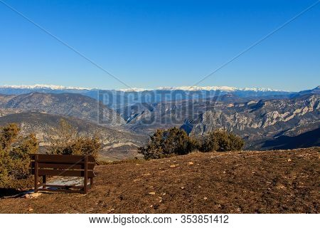 Brown Wooden Bench In The Mountain.concept Objects In Nature
