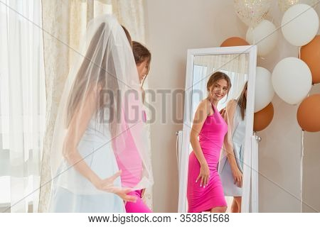Side View Of Two Happy Smiling Brunette Girls Preparing For Wedding In Morning. Young Incognito Brid