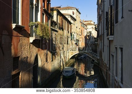 View Of Footbridge And Boat In Venice, Italy