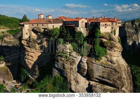 Monastery of Varlaam monastery in famous greek tourist destination Meteora in Greece on sunset with scenic scenery landscape