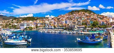Best of Greece - travel in Lesvos Island, scenic  colorful Plomarion town with traditional fishing boats