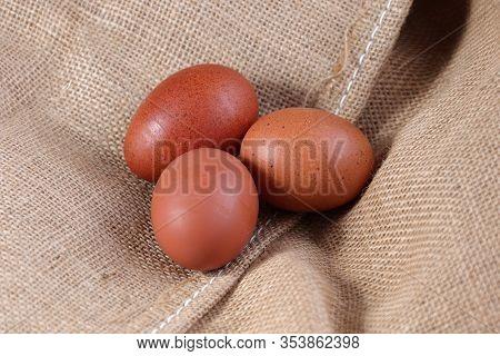 Chicken Eggs On A Burlap Hessian Sack