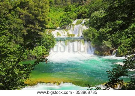 A Picturesque Cascade Waterfall Among Large Stones In The Krka Landscape Park, Croatia In Spring Or