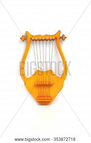 Lyre Isolated Against Light Background Flat Lay. Image Contains Copy Space