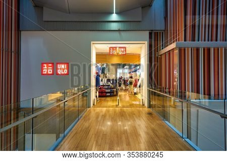 SINGAPORE - CIRCA JANUARY, 2020: entrance to UNIQLO Orchard Central, Global Flagship Store. The store spans three floors and is located in Orchard Road shopping belt.