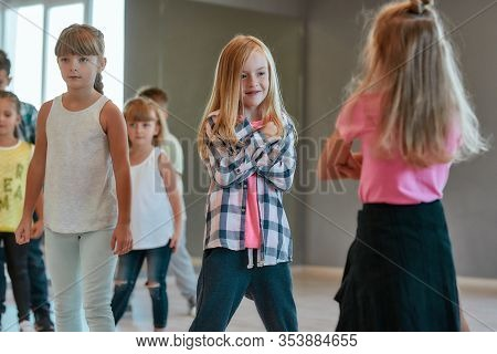 Hip Hop Style. Group Of Cute Positive Children Learning A Modern Dance In The Dance Studio. Choreogr
