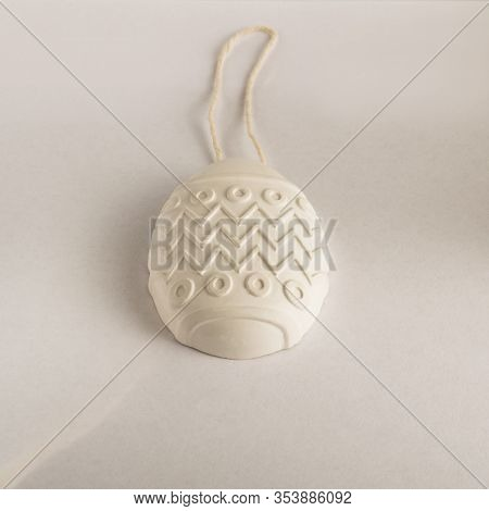 White Easter Egg. Gypsum Medallion Casting. Plaster Product For Coloring On A Rope
