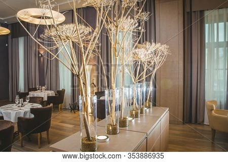 Valencia, Spain - March 19, 2019: Flowers Decorating The Centerpieces With Luxury Cutlery On The Tab