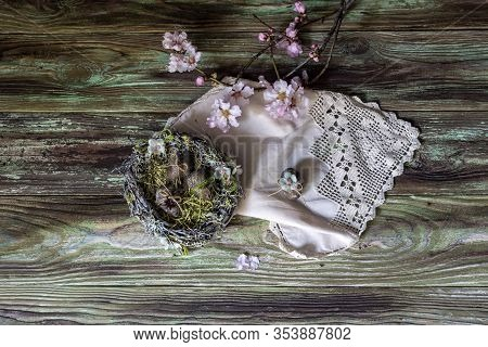 The Easter Composition.  A Bouquet With Almond Branches, Nest And Eggs In Vintage Style On Wooden Ta