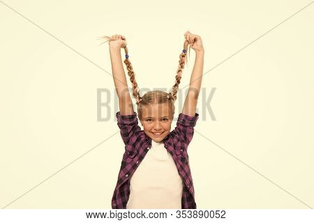 Long And Plaited. Happy Small Girl Hold Long Blond Braids. Adorable Little Child Smile With Long Pla