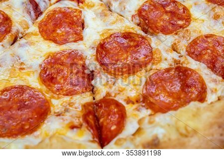 Sliced Hot Delicious Pepperoni Pizza Close Up.