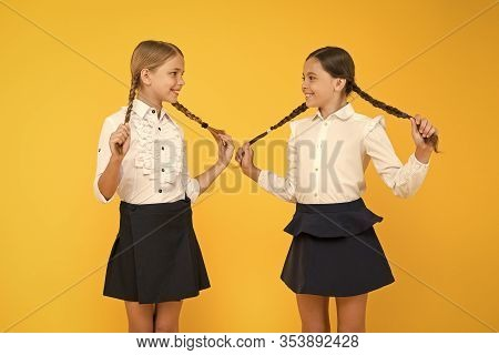 Hair Easy To Do Yourself. Adorable Little Girls With Plaited Hair On Yellow Background. Cute Small C