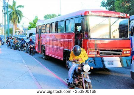 February 26, 2020 In Guatemala City, Guatemala:  Rush Hour Traffic Including Crowded Buses And Motor