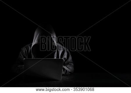 Dangerous Anonymous Hacker Man In Black Hooded Using Computer, Breaking Into Security Data Corporate