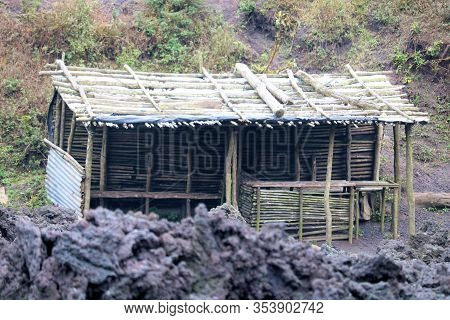 Rustic Wooden Shack Next To A Lava Field Taken At The Pacaya Volcanic Mountain Which Is Currently An