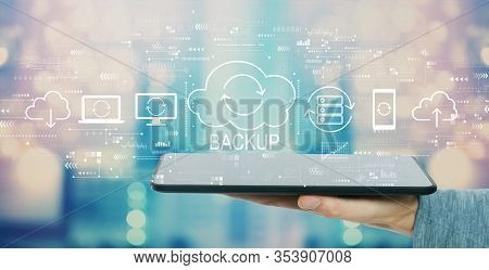 Backup Concept With Man Holding A Tablet Computer