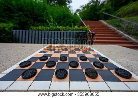 Wide Angle Shot Of Checkerboard On Outdoor Park Table