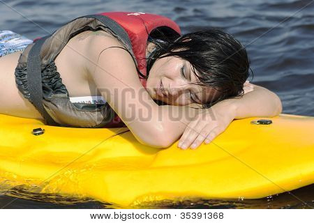 Tired girl lies on surfing