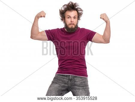 Crazy bearded Man with funny Haircut raised his hands and shows biceps. Serious handsome guy, isolated on white background. Strong male flexing biceps and looking at camera.