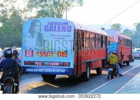 February 25, 2020 In Guatemala City, Guatemala:  People Riding On Busses Which Are Ex School Busses