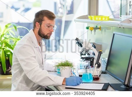 Scientist working in lab. Doctor making microbiology research. Laboratory tools: microscope, test tubes, equipment. Biotechnology, genetics, biochemistry, pharmaceutical, dna and health care.