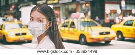 Corona virus travel ban China woman tourist walking in New York city street wearing surgical mask coronavirus protection, outbreak spreading scare. Panoramic banner background of traffic taxi cabs.