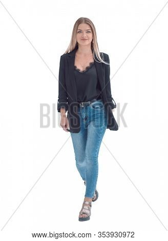 in full growth. a young woman in a black blazer steps forward