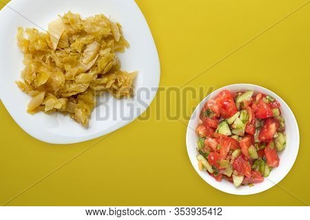 Stewed Cabbage In A White Plate On A Yellow Background. Stewed Cabbage Top View. Healthy Eating. Veg